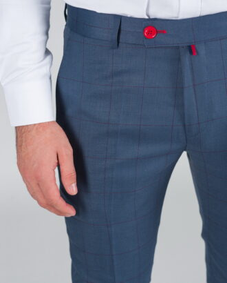 Синие брюки с контрастной клеткой